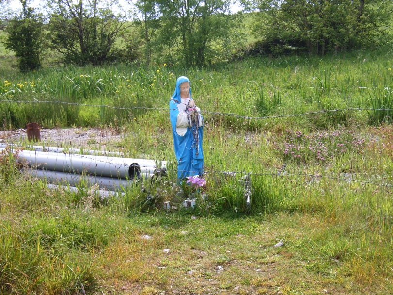 Statue of the Blessed Virgin beside holy well