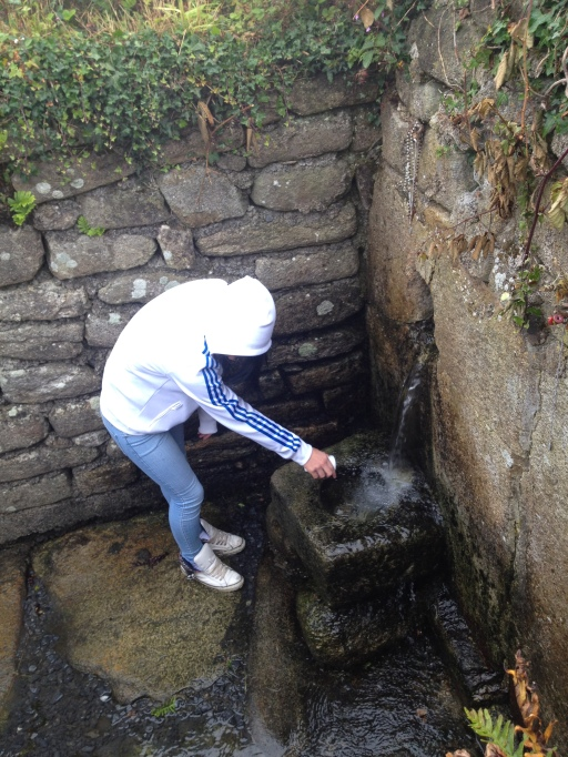 girl collecting water at st mullins