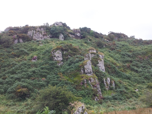 View of St Kevin's Cave and St Kevin's Bed from valley floor