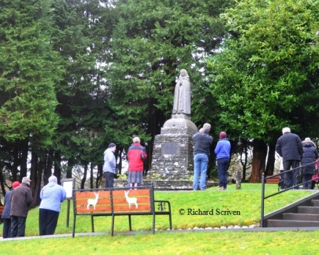 Pilgrims praying at the statue of St Gobnait as part of the rounds on St Gobnait's Day (11th Feb) 2013.