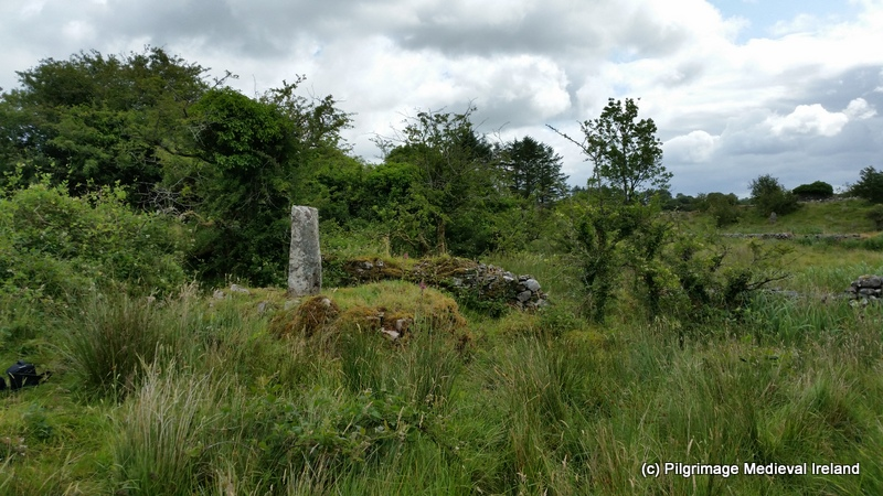 View of penitental cairn with ogham stone beside Tobar na Bachaile