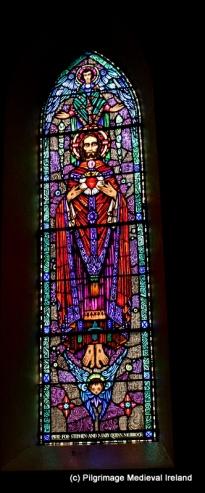 Harry Clarke window of Christ in resurrection
