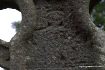 Figure at base of wheel of the western face of high cross at Killamery perhaps depicting creation day