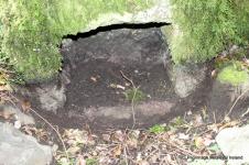 Recess at base of boulder at St Nicholas holy well Killamery