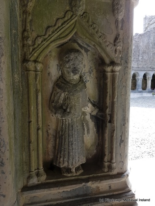 Carving of St Francis in the northeast corner of the cloister at Askeaton Friary..