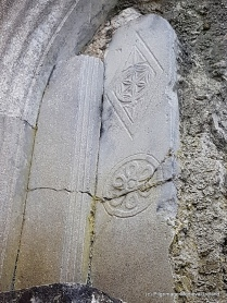 Carving with floral design inserted above sedilia in northeast corner of the churchat Askeaton Friary.