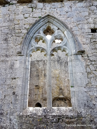 Finely carved window in south wall of church at Askeaton Friary.