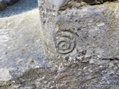 Tiny carving of a spiral at the base of the doorway leading into sacristry at Askeaton Friary.